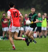15 August 2020; Stephen Cluxton of Parnells sets up an attack as Niall James of Cuala closes in during the Dublin County Senior 2 Football Championship Group 2 Round 3 match between Cuala and Parnells at Hyde Park in Glenageary, Dublin. Photo by Piaras Ó Mídheach/Sportsfile
