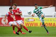 16 August 2020; Neil Farrugia of Shamrock Rovers in action against Dan Ward, left, and Rory Feely of St Patrick's Athletic during the SSE Airtricity League Premier Division match between St Patrick's Athletic and Shamrock Rovers at Richmond Park in Dublin. Photo by Stephen McCarthy/Sportsfile
