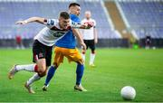 19 August 2020; Sean Gannon of Dundalk in action against Luka Kerin of NK Celja during the UEFA Champions League First Qualifying Round match between NK Celja and Dundalk at Ferenc Szusza Stadion in Budapest, Hungary. Photo by Vid Ponikvar/Sportsfile