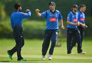 20 August 2020; Simi Singh of Leinster Lightning, left, is congratulated by team-mate Tyrone Kane after claiming the wicket of Jonathan Garth of Munster Reds during the 2020 Test Triangle Inter-Provincial Series match between Leinster Lightning and Munster Reds at Pembroke Cricket Club in Dublin. Photo by Seb Daly/Sportsfile