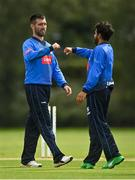 20 August 2020; Simi Singh of Leinster Lightning, right, is congratulated by Andrew Balbirnie after bowling out Munster Reds' Ruadhan Jones during the 2020 Test Triangle Inter-Provincial Series match between Leinster Lightning and Munster Reds at Pembroke Cricket Club in Dublin. Photo by Seb Daly/Sportsfile