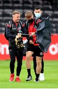 22 August 2020; Bohemians players Keith Ward, left, and JJ Lunney struggle with their umbrella on arrival prior to the SSE Airtricity League Premier Division match between Bohemians and St Patrick's Athletic at Dalymount Park in Dublin. Photo by Stephen McCarthy/Sportsfile