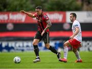 22 August 2020; Rob Cornwall of Bohemians in action against Robbie Benson of St Patrick's Athletic during the SSE Airtricity League Premier Division match between Bohemians and St Patrick's Athletic at Dalymount Park in Dublin. Photo by Stephen McCarthy/Sportsfile