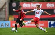 22 August 2020; Danny Grant of Bohemians in action against Jamie Lennon of St Patrick's Athletic during the SSE Airtricity League Premier Division match between Bohemians and St Patrick's Athletic at Dalymount Park in Dublin. Photo by Stephen McCarthy/Sportsfile