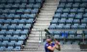 22 August 2020; A general view of empty seats in the stand, as the match was closed to the public, as Donal Burke of Na Fianna takes a free during the Dublin County Senior A Hurling Championship Quarter-Final match between Na Fianna and Faughs at Parnell Park in Dublin. Photo by Piaras Ó Mídheach/Sportsfile