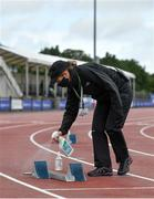 22 August 2020; Official Jacqueline Mulhall sanitises a set of blocks between races during Day One of the Irish Life Health National Senior and U23 Athletics Championships at Morton Stadium in Santry, Dublin. Photo by Sam Barnes/Sportsfile
