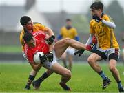 22 August 2020; David Clifford of East Kerry is tackled by Sean T Dillon, left, and Muiroch McNulty of Feale Rangers during the Kerry County Senior Football Championship Round 1 match between Feale Rangers and East Kerry at Frank Sheehy Park in Listowel, Kerry. Photo by Brendan Moran/Sportsfile
