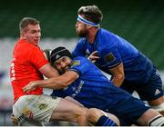 22 August 2020; Chris Farrell of Munster is tackled by Scott Fardy of Leinster supported by team-mamte Caelan Doris during the Guinness PRO14 Round 14 match between Leinster and Munster at the Aviva Stadium in Dublin. Photo by Ramsey Cardy/Sportsfile