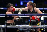 22 August 2020; Katie Taylor, left, takes a right from Delfine Persoon during their Undisputed Lightweight Titles fight at Brentwood in Essex, England. Photo by Mark Robinson / Matchroom Boxing via Sportsfile