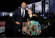 22 August 2020; Katie Taylor with promoter Eddie Hearn after her Undisputed Lightweight Titles fight against Delfine Persoon at Brentwood in Essex, England. Photo by Mark Robinson / Matchroom Boxing via Sportsfile