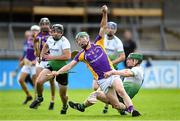 23 August 2020; Fergal Whitely of Kilmacud Crokes is fouled by Johnny McCaffrey of Lucan Sarsfields, before McCaffrey was shown a yellow card by referee Damien Burnett, during the Dublin County Senior A Hurling Championship Quarter-Final match between Kilmacud Crokes and Lucan Sarsfields at Parnell Park in Dublin. Photo by Piaras Ó Mídheach/Sportsfile