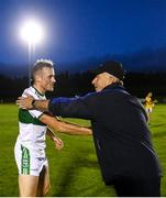 24 August 2020; Ballylinan manager Mick Lillis shakes hands with son and opposing player Kieran Lillis of Portlaoise during the Laois County Senior Football Championship Round 1 match between Ballylinan and Portlaoise GAA at Stradbally GAA in Stradbaly, Laois. Photo by David Fitzgerald/Sportsfile