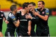 25 August 2020; Eoin Toal, second from left, celebrates with Derry City team-mates, from left, Ciáran Coll, Stephen Mallon and Joe Thomson after scoring their second goal during the UEFA Europa League First Qualifying Round match between FK Riteriai and Derry City at LFF Stadium in Vilnius, Lithuania. Photo by Saulius Cirba/Sportsfile