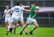 1 August 2020; Greth Bradshaw of Moycullen in action against Mícheál Breathnach's players, Ruadhan Ó Curraoin, 15, and Dara Mac Dubhghaill during the Galway County Senior Football Championship Group 2 Round 1 match between Moycullen and Mícheál Breathnach's at Pearse Stadium in Galway. GAA matches continue to take place in front of a limited number of people in an effort to contain the spread of the Coronavirus (COVID-19) pandemic. Photo by Piaras Ó Mídheach/Sportsfile