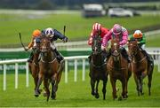 28 August 2020; Laughifuwant, left, with Colin Keane up, races alongside eventual third place Breaking Story, right, with Robbie Colgan up, on their way to winning the Paddy Power Irish Cambridgeshire at The Curragh Racecourse in Kildare. Photo by Seb Daly/Sportsfile