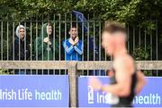 29 August 2020; Olympian and race walking coach Robert Heffernan, centre, watches on from outside the stadium as David Kenny of Farranfore Maine Valley AC, Kerry, competes in the Men's 10,000m Walk event during day three of the Irish Life Health National Senior and U23 Athletics Championships at Morton Stadium in Santry, Dublin. Photo by Sam Barnes/Sportsfile