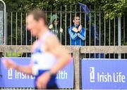 29 August 2020; Olympian and race walking coach Robert Heffernan, right, watches on from outside the stadium as Brendan Boyce of Finn Valley AC, Donegal, competes in the Men's 10,000m Walk event during day three of the Irish Life Health National Senior and U23 Athletics Championships at Morton Stadium in Santry, Dublin. Photo by Sam Barnes/Sportsfile