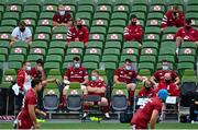 30 August 2020; Munster substitutes sit on the bench in the final moments of the Guinness PRO14 Round 15 match between Munster and Connacht at the Aviva Stadium in Dublin. Photo by Ramsey Cardy/Sportsfile