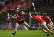 30 August 2020; Kevin Mahony of Ballygunner scores a point under pressure from David Jones and Noel Connors of Passage during the Waterford County Senior Hurling Championship Final match between Passage and Ballygunner at Walsh Park in Waterford. Photo by Seb Daly/Sportsfile