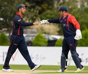 3 September 2020; Ruan Pretorius, left, of Northern Knights is congratulated by his team captain Gary Wilson after taking the wicket of Kevin O'Brien of Leinster Lightning during the Test Triangle Inter-Provincial Series 2020 match between Leinster Lightning and Northern Knights at Pembroke Cricket Club in Dublin. Photo by Matt Browne/Sportsfile
