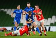4 September 2020; Garry Ringrose of Leinster is tackled by Craig Casey, left, and Shane Daly of Munster during the Guinness PRO14 Semi-Final match between Leinster and Munster at the Aviva Stadium in Dublin. Photo by Ramsey Cardy/Sportsfile