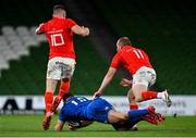 4 September 2020; Jordan Larmour of Leinster takes a knock as JJ Hanrahan of Munster attempts to kick the ball during the Guinness PRO14 Semi-Final match between Leinster and Munster at the Aviva Stadium in Dublin. Photo by Brendan Moran/Sportsfile
