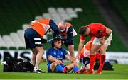4 September 2020; Jordan Larmour of Leinster is checked on by JJ Hanrahan of Munster as he receives medical attention during the Guinness PRO14 Semi-Final match between Leinster and Munster at the Aviva Stadium in Dublin. Photo by Brendan Moran/Sportsfile