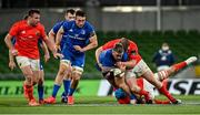 4 September 2020; Andrew Porter of Leinster is tackled by Niall Scannell, left, and Stephen Archer of Munster during the Guinness PRO14 Semi-Final match between Leinster and Munster at the Aviva Stadium in Dublin. Photo by Ramsey Cardy/Sportsfile