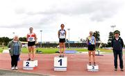 5 September 2020; Athletics Ireland President Georgina Drumm, left, alongside Women's 3000m Steeplechase medallists, from left, Sarah Gilhooley of Galway City Harriers AC, silver, Cara McNally of Lusk AC, Dublin, gold, and Niamh McDonald of Ballyroan Abbeyleix and District AC, bronze, during the Irish Life Health National Junior Track and Field Championships at Morton Stadium in Santry, Dublin. Photo by Sam Barnes/Sportsfile