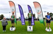 5 September 2020; Athletics Ireland President Georgina Drumm, left, alongside Junior Men's Weight for Distance medallists, from left, Azuolas Varnili of Templemore AC, Tipperary, silver, Robert Higgins of Na Fianna AC, Meath, gold, Eoghan Murphy of Tara AC, Meath, bronze, during the Irish Life Health National Junior Track and Field Championships at Morton Stadium in Santry, Dublin. Photo by Sam Barnes/Sportsfile