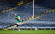 5 September 2020; A general view of empty seats in the stand as John McGrath of Loughmore-Castleiney scores a point from a free during the Tipperary County Senior Hurling Championship Semi-Final match between Nenagh Éire Óg and Loughmore/Castleiney at Semple Stadium in Thurles, Tipperary. Photo by Piaras Ó Mídheach/Sportsfile