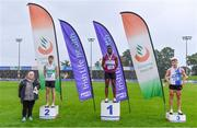 5 September 2020; Athletics Ireland President Georgina Drumm, left, alongside Junior Men's 200m medallists, from left, Michael Farrelly of Raheny Shamrock AC, Dublin, silver, Charles Okafor of Mullingar Harriers AC, Westmeath, gold, and Aaron Keane of Tullamore Harriers AC, Offaly, bronze, during the Irish Life Health National Junior Track and Field Championships at Morton Stadium in Santry, Dublin. Photo by Sam Barnes/Sportsfile