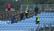 5 September 2020; Members of An Garda Siochána escort people out of the ground during the Mayo County Senior Football Championship Semi-Final match between Breaffy and Westport at Elvery's MacHale Park in Castlebar, Mayo. Photo by Brendan Moran/Sportsfile