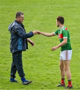 6 September 2020; Knockmore manager Ray Dempsey fist bumps Simon Leonard of Ballina Stephenites after the Mayo County Senior Football Championship Semi-Final match between Knockmore and Ballina Stephenites at Elvery's MacHale Park in Castlebar, Mayo. Photo by Brendan Moran/Sportsfile