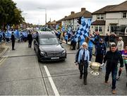 8 September 2020; Members of the funeral procession with the hearse and the Sam Maguire Cup make their way to the funeral of Dublin GAA supporter Tony Broughan, who was better known as Molly Malone at matches, at the Church Of The Most Precious Blood in Cabra, Dublin. Photo by Harry Murphy/Sportsfile