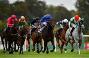 12 September 2020; Halimi, centre, with Kevin Manning up, races alongside eventual third place Powerful Ted, left, with Colin Keane up, on their way to winning the Irish Stallion Farms EBF 'Petingo' Handicap during day one of The Longines Irish Champions Weekend at Leopardstown Racecourse in Dublin. Photo by Seb Daly/Sportsfile