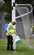 12 September 2020; Martin Keane sanitises the white flag beside the goal posts before the Clare County Senior Hurling Championship Semi-Final match between Sixmilebridge and Eire Óg at Cusack Park in Ennis, Clare. Photo by Ray McManus/Sportsfile