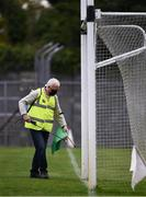 12 September 2020; Martin Keane sanitises the green flag beside the goal posts before the Clare County Senior Hurling Championship Semi-Final match between Sixmilebridge and Eire Óg at Cusack Park in Ennis, Clare. Photo by Ray McManus/Sportsfile