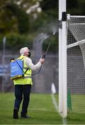 12 September 2020; Martin Keane sanitises the goal posts before the Clare County Senior Hurling Championship Semi-Final match between Sixmilebridge and Eire Óg at Cusack Park in Ennis, Clare. Photo by Ray McManus/Sportsfile