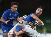 12 September 2020; James Lowe of Leinster is tackled by Michael Lowry, 15, and Jacob Stockdale of Ulster during the Guinness PRO14 Final match between Leinster and Ulster at the Aviva Stadium in Dublin. Photo by Ramsey Cardy/Sportsfile
