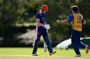 13 September 2020; Harry Tector of YMCA, left, leaves the field after being bowled by Rudolph Pollard of Cork County, right, during the All-Ireland T20 Semi-Final match between YMCA and Cork County at Pembroke Cricket Club in Dublin. Photo by Sam Barnes/Sportsfile