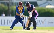 13 September 2020; Robert Gamble of YMCA plays a shot as Benjamin Marris of Cork County  watches on during the All-Ireland T20 Semi-Final match between YMCA and Cork County at Pembroke Cricket Club in Dublin. Photo by Sam Barnes/Sportsfile