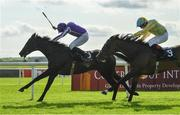 13 September 2020; Shale, left with Ryan Moore up, races alongside eventual second place Pretty Gorgeous, with Declan McDonogh up, on their way to winning the Moyglare Stud Stakes during day two of The Longines Irish Champions Weekend at The Curragh Racecourse in Kildare. Photo by Seb Daly/Sportsfile