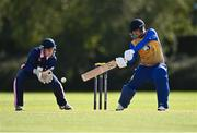 13 September 2020; Benjamin Marris of Cork County plays a shot watched by JJ Cassidy of YMCA during the All-Ireland T20 Semi-Final match between YMCA and Cork County at Pembroke Cricket Club in Dublin. Photo by Sam Barnes/Sportsfile