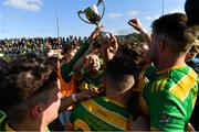 13 September 2020; Dunloy captain Paul Shiels, centre, and his team-mates celebrate with the cup after the Antrim County Senior Hurling Championship Final match between Dunloy Cuchullains and Loughgiel Shamrocks at Páirc Mhic Uilín in Ballycastle, Antrim. Photo by Brendan Moran/Sportsfile