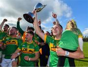 13 September 2020; Dunloy captain Paul Shields, carrying his daughter Ada, and his team-mates celebrate with the cup after the Antrim County Senior Hurling Championship Final match between Dunloy Cuchullains and Loughgiel Shamrocks at Páirc Mhic Uilín in Ballycastle, Antrim. Photo by Brendan Moran/Sportsfile