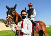 13 September 2020; Jockey Oisin Orr celebrates with groom Carlos Athilas after riding Search For A Song to victory in the Comer Group International Irish St Leger during day two of The Longines Irish Champions Weekend at The Curragh Racecourse in Kildare. Photo by Seb Daly/Sportsfile