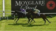 13 September 2020; Shale, left with Ryan Moore up, passes the post ahead of second place Pretty Gorgeous, with Declan McDonogh up, to win the Moyglare Stud Stakes during day two of The Longines Irish Champions Weekend at The Curragh Racecourse in Kildare. Photo by Seb Daly/Sportsfile