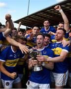 13 September 2020; David Lavery of Maghery Seán MacDiarmada, centre, lifts the cup and celebrates with team-mates following the Armagh County Senior Football Championship Final match between Crossmaglen Rangers and Maghery Seán MacDiarmada at the Athletic Grounds in Armagh. Photo by David Fitzgerald/Sportsfile