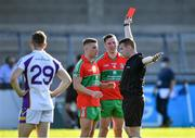 13 September 2020; Leon Young of Ballymun Kickhams, 7,  is shown the red card by referee James King late in the second half as team-mate Philly McMahon looks on during the Dublin County Senior Football Championship Semi-Final match between Ballymun Kickhams and Kilmacud Crokes at Parnell Park in Dublin. Photo by Piaras Ó Mídheach/Sportsfile
